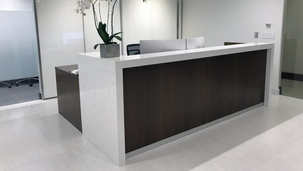 "Reception station: 18""x79"" Wood Veneer L-Shape Desk w/ Quartz Transaction Top"